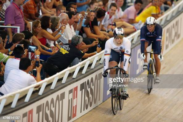 Stefan Botticher of Germany rides against Francois Pervis of France in the Gold Final of the Men's Sprint on day five of the 2014 UCI Track Cycling...