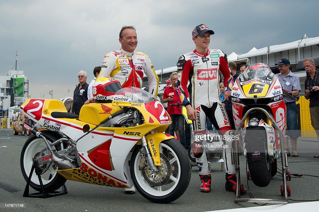 Stefan Bradl (L) of Germany and LCR Honda MotoGP and his father Helmut Bradl of Germany pose with their the bikes on grid during the pre-event 'MotoGP riders celebrate Sachsenring's 85th Anniversary' during the MotoGp of Germany at Sachsenring Circuit on July 5, 2012 in Hohenstein-Ernstthal, Germany.