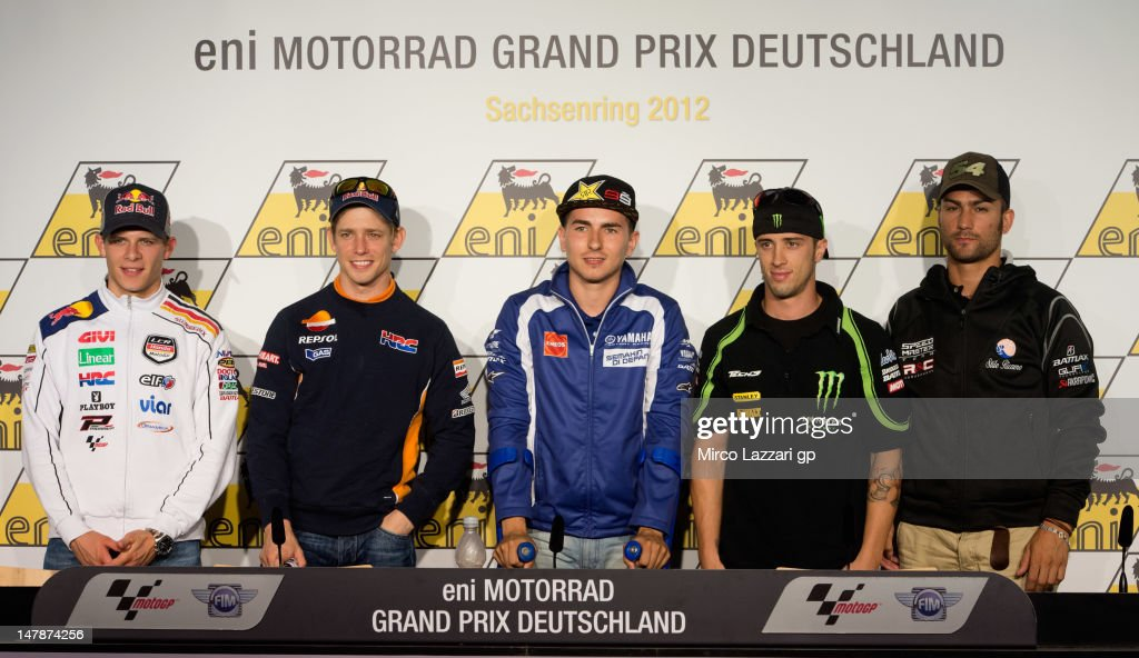 Stefan Bradl of Germany and LCR Honda MotoGP, Casey Stoner of Australia and Repsol Honda Team, Jorge Lorenzo of Spain and Yamaha Factory Team, Andrea Dovizioso of Italy and Yamaha Tech 3 and Mattia Pasini of Italy and Speed Master pose during the pre-event press conference before the MotoGp of Germany at Sachsenring Circuit on July 5, 2012 in Hohenstein-Ernstthal, Germany.