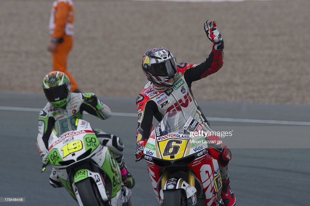 <a gi-track='captionPersonalityLinkClicked' href=/galleries/search?phrase=Stefan+Bradl&family=editorial&specificpeople=4956082 ng-click='$event.stopPropagation()'>Stefan Bradl</a> of Germany and LCR Honda MotoGP greets the fans at the end of the MotoGP race during the MotoGp of Germany - Race at Sachsenring Circuit on July 14, 2013 in Hohenstein-Ernstthal, Germany.