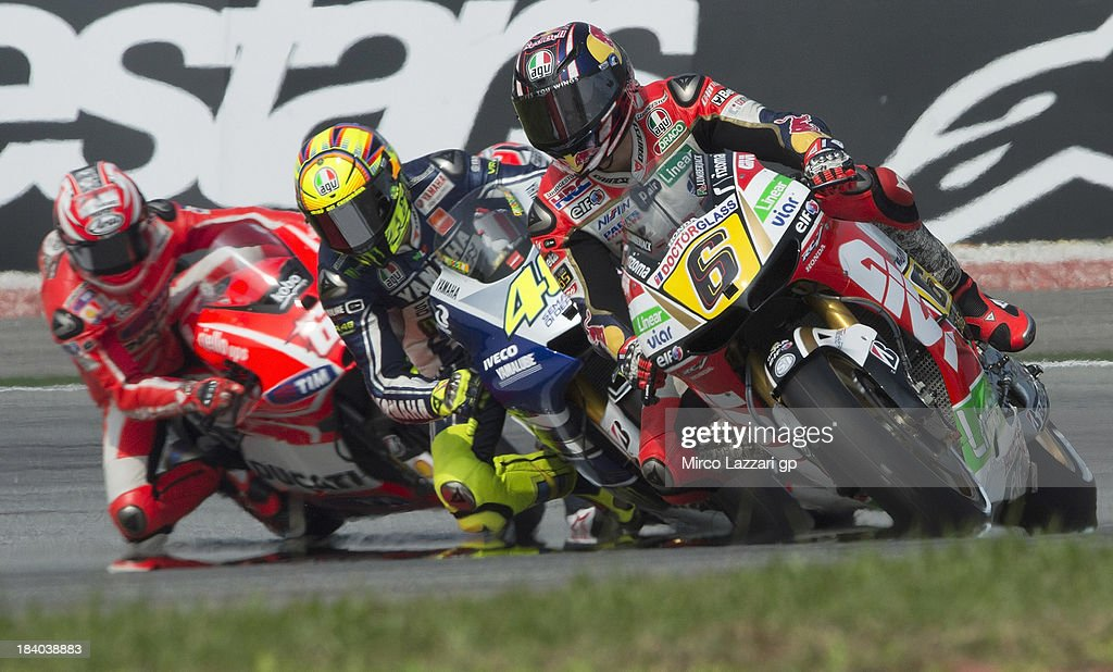 <a gi-track='captionPersonalityLinkClicked' href=/galleries/search?phrase=Stefan+Bradl&family=editorial&specificpeople=4956082 ng-click='$event.stopPropagation()'>Stefan Bradl</a> of Germany and LCR Honda MotoGP leads the field during the MotoGP Of Malaysia - Free Practice at Sepang Circuit on October 11, 2013 in Kuala Lumpur, Malaysia.