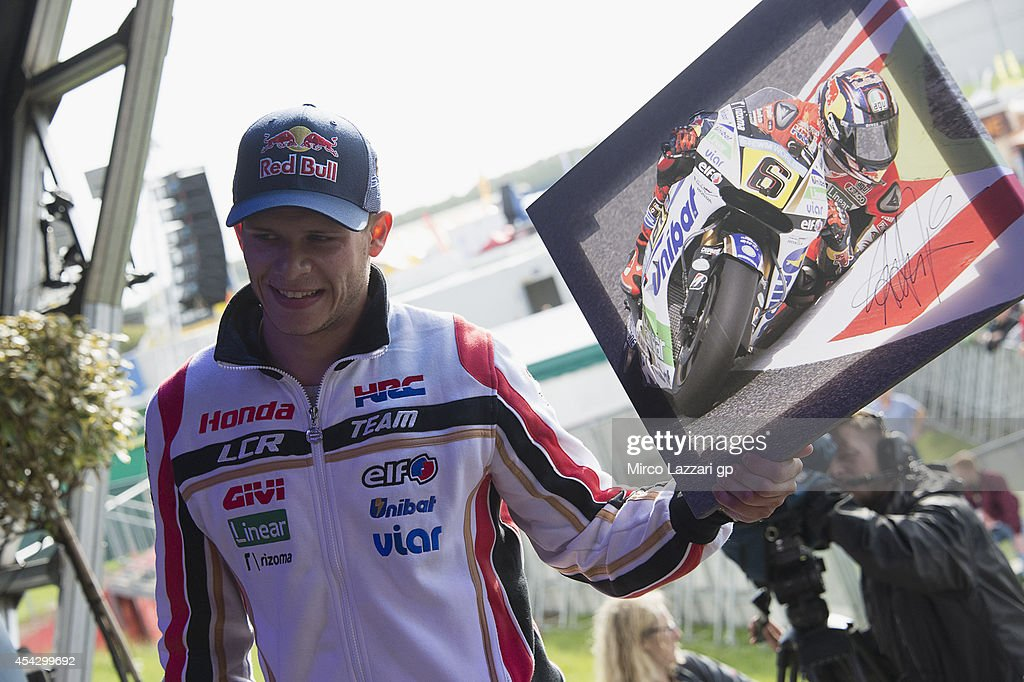 <a gi-track='captionPersonalityLinkClicked' href=/galleries/search?phrase=Stefan+Bradl&family=editorial&specificpeople=4956082 ng-click='$event.stopPropagation()'>Stefan Bradl</a> of Germany and LCR Honda MotoGP smiles during the pre-event 'Riders for Health' during the MotoGp Of Great Britain - Press Conference And Day of Champions at Silverstone Circuit on August 28, 2014 in Northampton, United Kingdom.