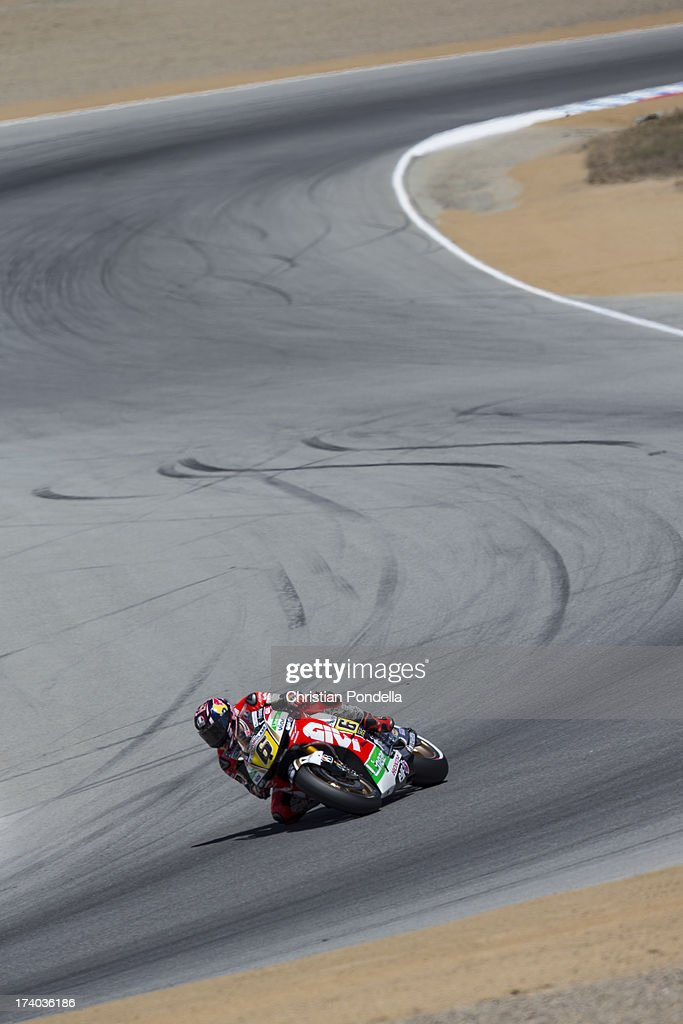 <a gi-track='captionPersonalityLinkClicked' href=/galleries/search?phrase=Stefan+Bradl&family=editorial&specificpeople=4956082 ng-click='$event.stopPropagation()'>Stefan Bradl</a> of Germany and Team LCR Honda MotoGP rounds the corner at the MotoGP race of Red Bull U.S. Grand Prix at Mazda Raceway Laguna Seca on July 19, 2013 in Monterey, California.