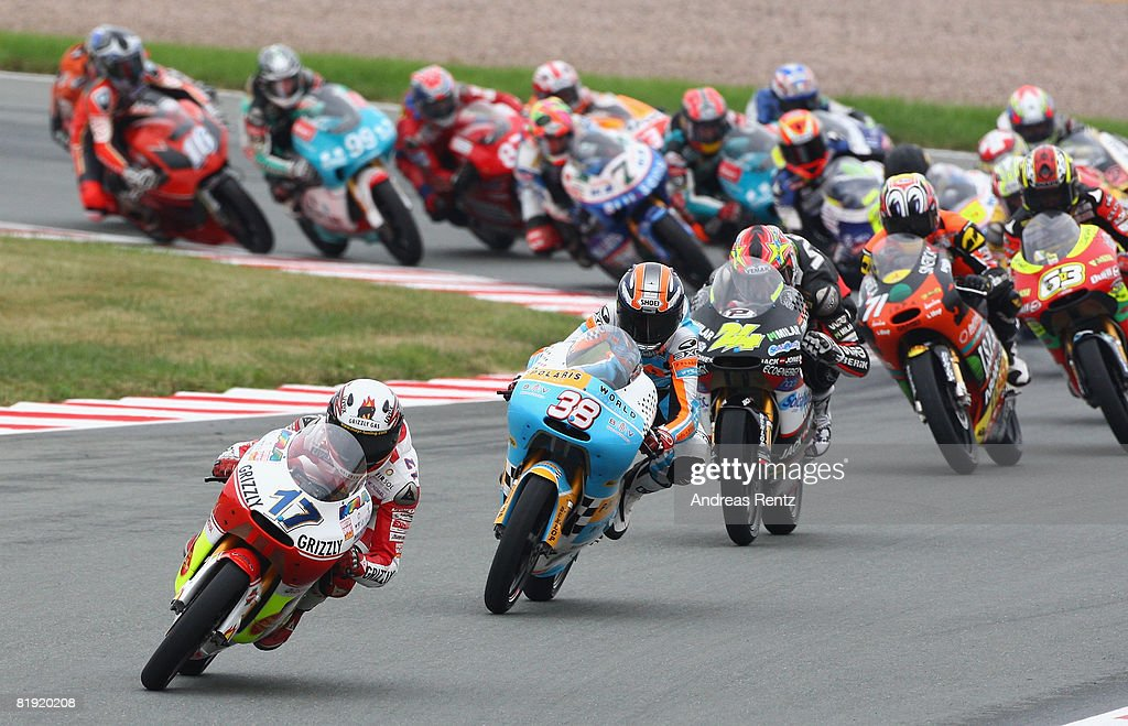 Stefan Bradl of Germany and the Grizzly Gas Kiefer Racing Team ahead of Bradley Smith of Great Britain and the Polaris World Team in action during...