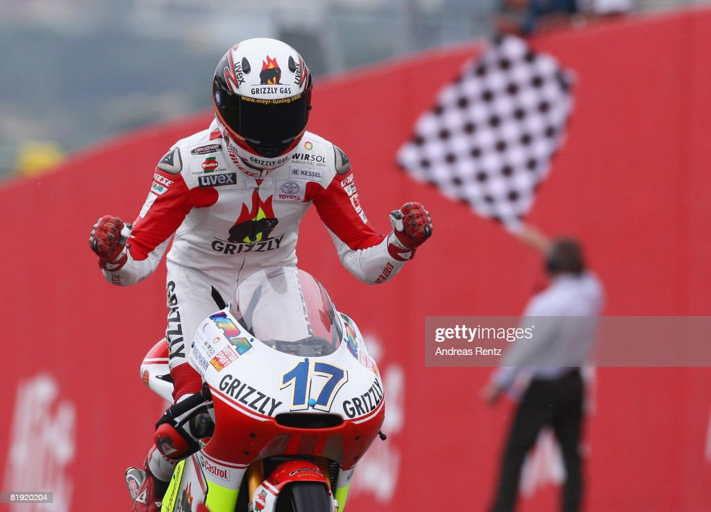 Stefan Bradl of Germany and the Grizzly Gas Kiefer Racing Team celebrate his second place during the 125cc race of the Grand Prix of Germany at...