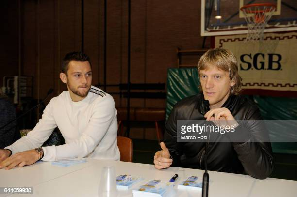 Stefan De Vrij and Dusan Basta of SS Lazio meets school students with his teammates on February 23 2017 in Rome Italy