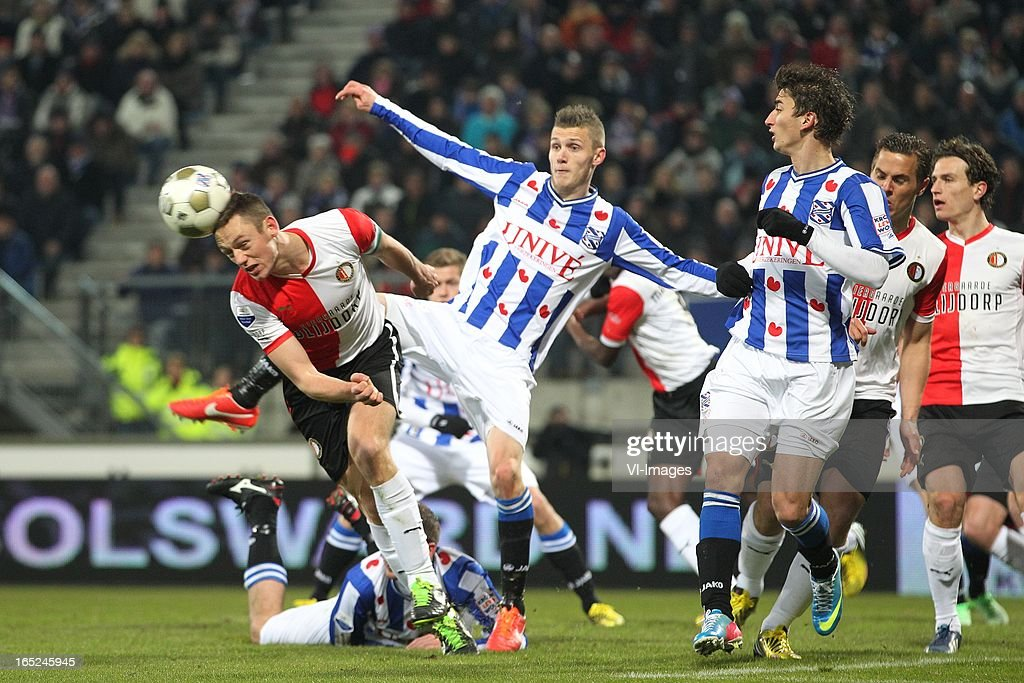 Stefan de Vrij of Feyenoord,Jeffrey Gouweleeuw of Heerenveen,Filip Djuricic of Heerenveen,Wesley Verhoek of Feyenoord during the Dutch Eredivisie match between SC Heerenveen and Feyenoord at the Abe Lenstra Stadium on march 30, 2013 in Heerenveen, The Netherlands