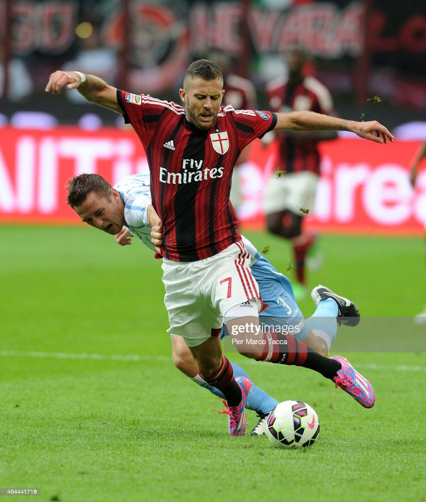 Stefan De Vrij of SS Lazio competes for the ball with Jeremy Menez during the Serie A match between AC Milan and SS Lazio at Stadio Giuseppe Meazza on August 31, 2014 in Milan, Italy.