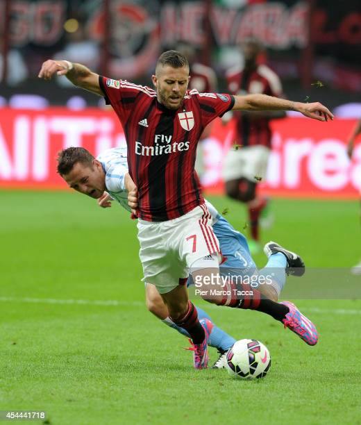 Stefan De Vrij of SS Lazio competes for the ball with Jeremy Menez during the Serie A match between AC Milan and SS Lazio at Stadio Giuseppe Meazza...