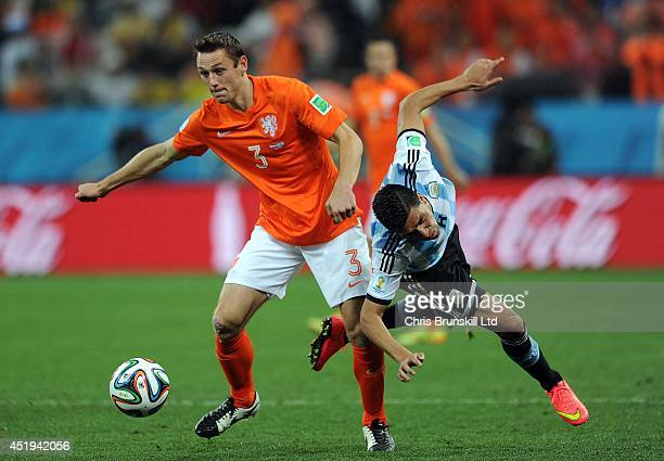 Stefan De Vrij of the Netherland in action with Enzo Perez of Argentina during the 2014 FIFA World Cup Brazil Semi Final match between Netherlands...