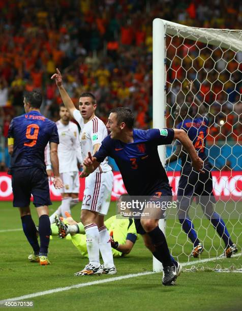 Stefan de Vrij of the Netherlands celebrates after scoring the team's third goal during the 2014 FIFA World Cup Brazil Group B match between Spain...