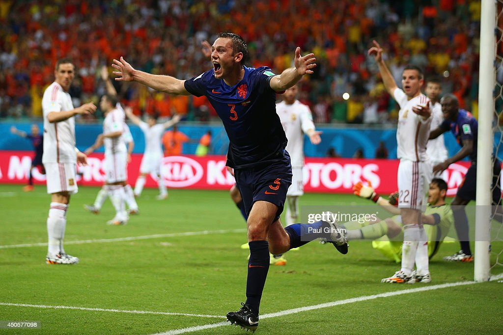 Stefan de Vrij of the Netherlands celebrates scoring the third goal during the 2014 FIFA World Cup Brazil Group B match between Spain and Netherlands at Arena Fonte Nova on June 13, 2014 in Salvador, Brazil.