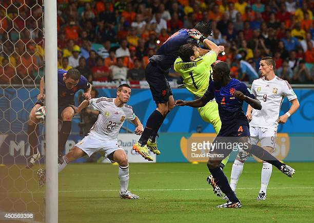 Stefan de Vrij of the Netherlands deflects the ball in for the teams third goal as Iker Casillas of Spain and Robin van Persie of the Netherlands...