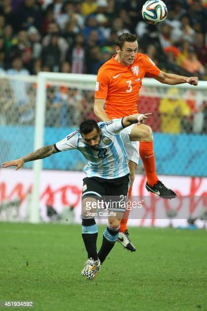 Stefan De Vrij of the Netherlands heads the ball over Ezequiel Lavezzi of Argentina during the 2014 FIFA World Cup Brazil Semi Final match between...