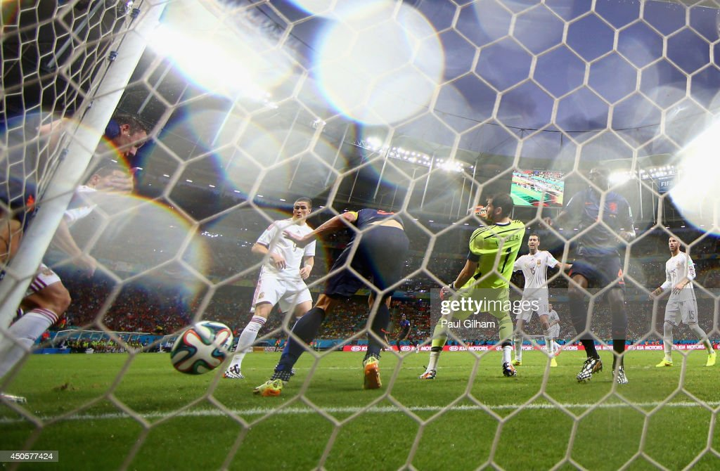 Stefan de Vrij of the Netherlands shoots and scores the team's third goal against Iker Casillas of Spain during the 2014 FIFA World Cup Brazil Group B match between Spain and Netherlands at Arena Fonte Nova on June 13, 2014 in Salvador, Brazil.