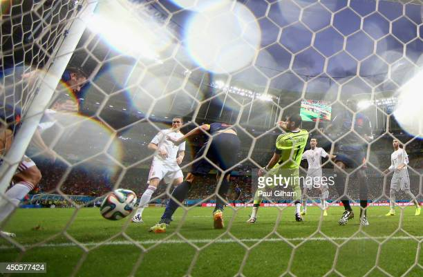 Stefan de Vrij of the Netherlands shoots and scores the team's third goal against Iker Casillas of Spain during the 2014 FIFA World Cup Brazil Group...