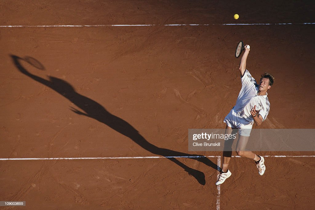 Stefan Edberg of Sweden reaches for an overhead return against Thomas Muster on 22nd April 1994 during the quarter final of the Men's Singles event...
