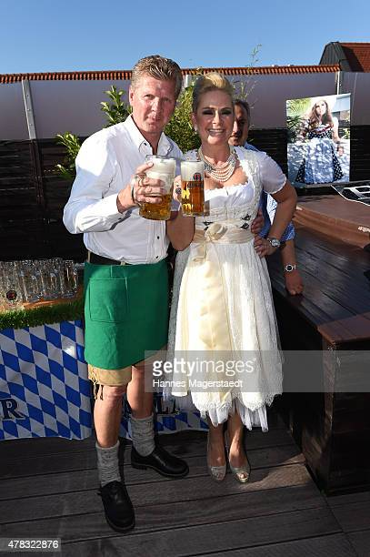 Stefan Effenberg and his wife Claudia Effenberg attend the 'Claudia Effenberg's Dirndl Launch Party' on June 24 2015 in Munich Germany