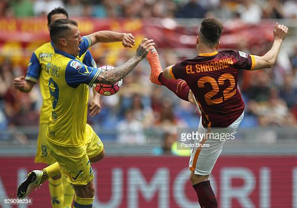 Stefan El Shaarawy of AS Roma competes for the ball with Fabrizio Cacciatore of AC Chievo Verona during the Serie A match between AS Roma and AC...