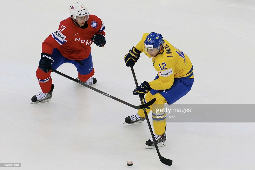 Stefan Espeland of Norway and Joakim Lindstrom of Sweden in action during the 2014 IIHF World Championship between Sweden and Norway at Chizhovka arena on May 13, 2014 in Minsk, Belarus.