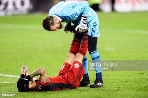 Stefan Frei of Seattle Sounders FC helps Sebastian Giovinco of Toronto FC with an injury during the second half of the 2017 MLS Cup Final between...