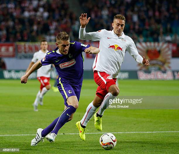 Stefan Ilsanker of Leipzig challenges Nils Petersen of Freiburg during the Second Bundesliga match between RB Leipzig and SC Freiburg at Red Bull...
