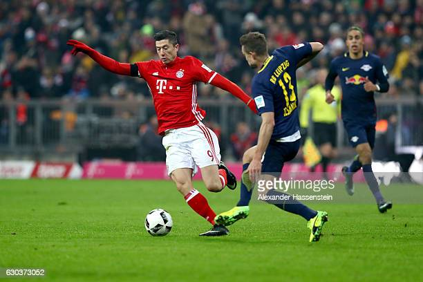 Stefan Ilsanker of RB Leipzig and Robert Lewandowski of Bayern Muenchen battle for possessionduring the Bundesliga match between Bayern Muenchen and...