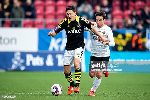Stefan Ishizaki of AIK and Nordin Gerzic of Orebro during the match between Orebro SK and AIK at Behrn Arena on October 31 2015 in Orebro Sweden