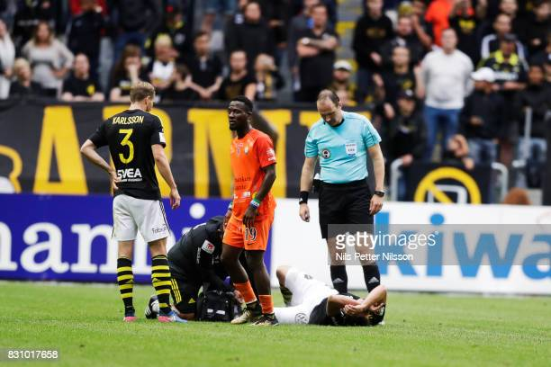 Stefan Ishizaki of AIK injured during the Allsvenskan match between AIK and Athletic FC Eskilstura at Friends arena on August 13 2017 in Solna Sweden
