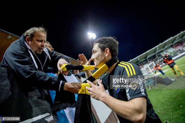 Stefan Ishizaki of AIK is given a scarf by a fan after the Allsvenskan match between Orebro SK AIK at Behrn Arena on November 5 2017 in Orebro Sweden
