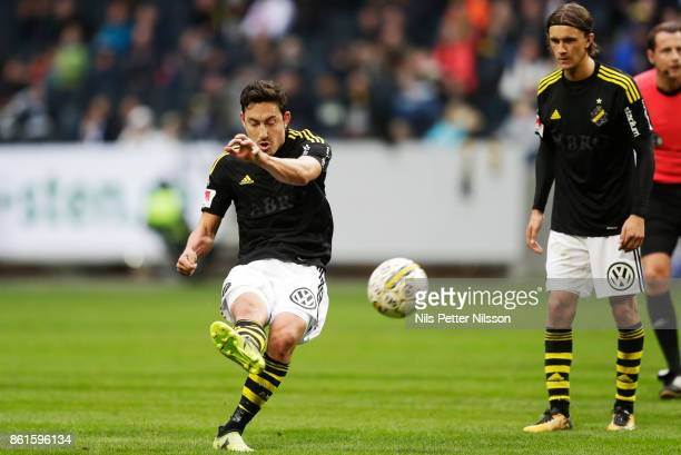 Stefan Ishizaki of AIK shoots a free kick during the Allsvenskan match between AIK and Jonkopings Sodra IF at Friends Arena on October 15 2017 in...