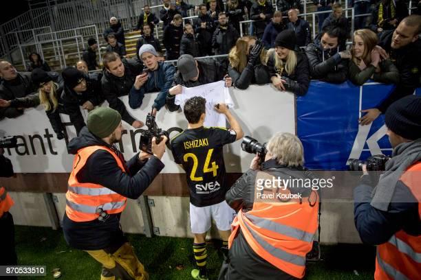 Stefan Ishizaki of AIK signs a fans tshirt during the Allsvenskan match between Orebro SK AIK at Behrn Arena on November 5 2017 in Orebro Sweden