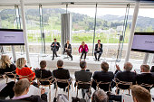 Stefan Isser Carla Rumler and Markus Langes Swarovski speak to the media at the press conference during the grand reopening of the Swarovski Crystal...