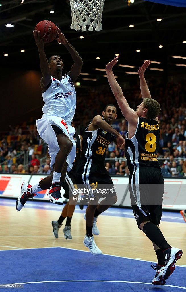 Stefan Jackson of Bremerhaven challenges for the ball with Lucca Satiger of Ludwigsburg during the Beko BBL basketball match between Eisbaeren...