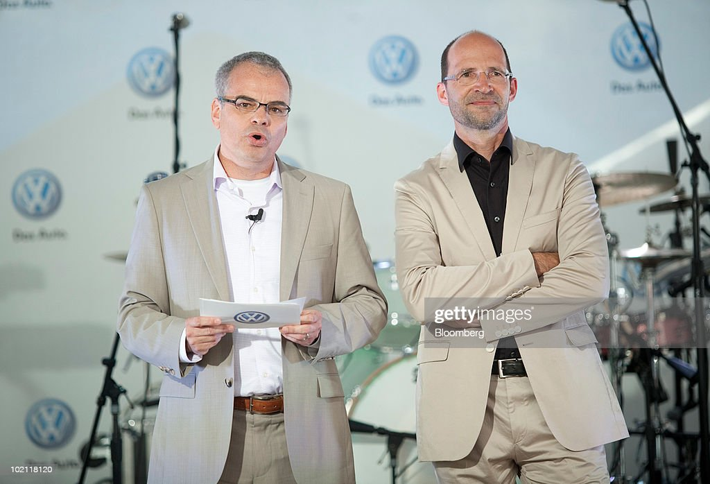 Stefan Jacoby, president and chief executive officer of Volkswagen of America Inc., left, speaks with Klaus Bischoff, chief designer for Volkswagen, at a news conference to unveil the 2011 Jetta in New York, U.S., on Tuesday, June 15, 2010. Volkswagen AG plans to cut the U.S. price and increase the size of the Jetta compact car, its best-selling model in the country, as the automaker seeks to almost double sales in the market by 2012. Photographer: JB Reed/Bloomberg via Getty Images