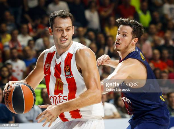 Stefan Jankovic of Crvena Zvezda in action against Thomas Huertel of Barcelona during the 2017/2018 Turkish Airlines EuroLeague Regular Season game...