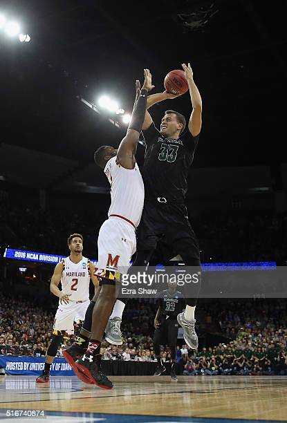 Stefan Jankovic of the Hawaii Warriors shoots against Robert Carter of the Maryland Terrapins in the first half during the second round of the 2016...