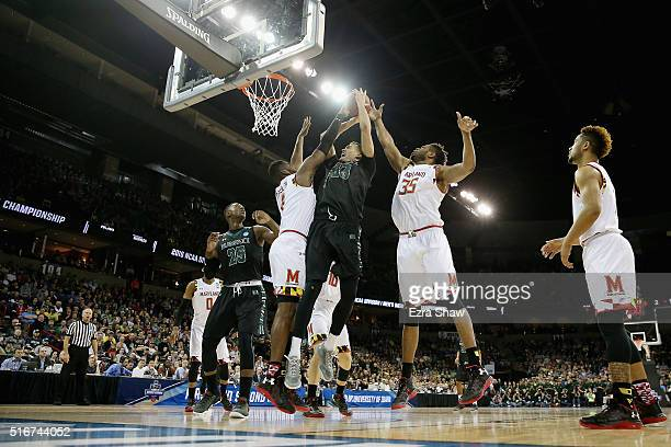 Stefan Jankovic of the Hawaii Warriors shoots against Robert Carter and Damonte Dodd of the Maryland Terrapins in the first half during the second...