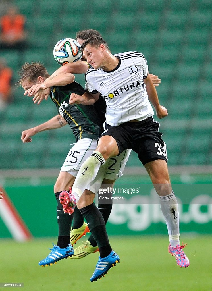 Stefan Johansen of Celtic competes with Michal Zyro of Legia during the third qualifying round UEFA Champions League match between Legia and Celtic at Pepsi Arena on July 30, 2014 in Warsaw, Poland.