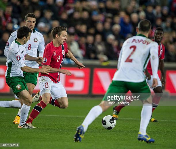 Stefan Johansen of Norway Andrej Galabinov of Bulgaria Apostol Popov of Bulgaria during the UEFA EURO 2016 qualifier match between Norway and...