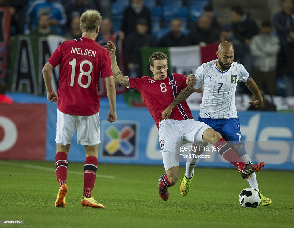 Stefan Johansen of Norway battles Simone Zaza of Italy during the UEFA EURO 2016 qualifier match between Norway and Italy at Ullevaal Stadion on September 9, 2014 in Oslo, Norway.