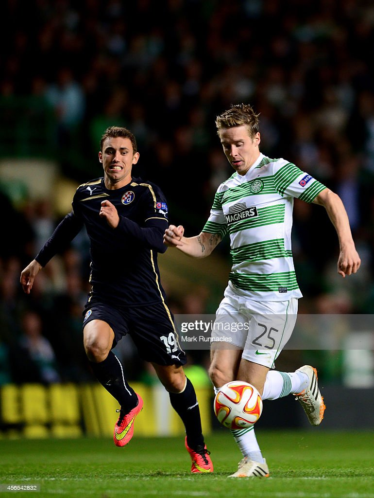 Stefan Johnansen of Celtic takes on Josip Pivaric of Dinamo Zagreb during the UEFA Europa League group D match between Celtic and Dinamo Zagreb at Celtic Park on October 02, 2014 in Glasgow Scotland.