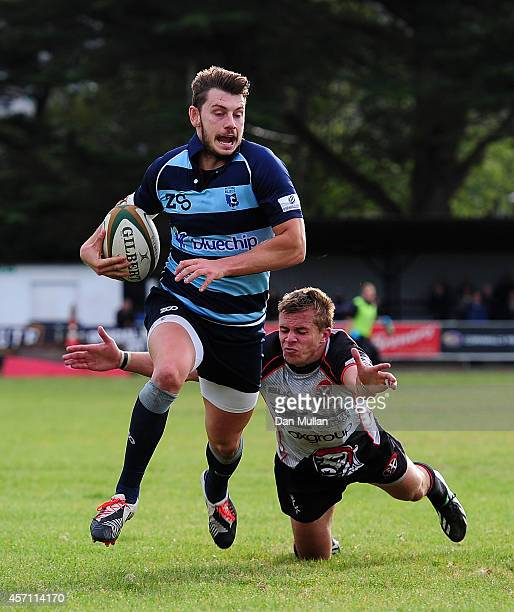 Stefan Jones of Bedford Blues beats Dean Adamson and goes over for a try during the British Irish Cup match between Cornish Pirates and Bedford Blues...