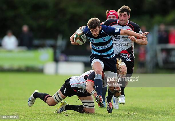 Stefan Jones of Bedford Blues breaks the tackle of Alex Cheesman of Cornish Pirates during the British Irish Cup match between Cornish Pirates and...