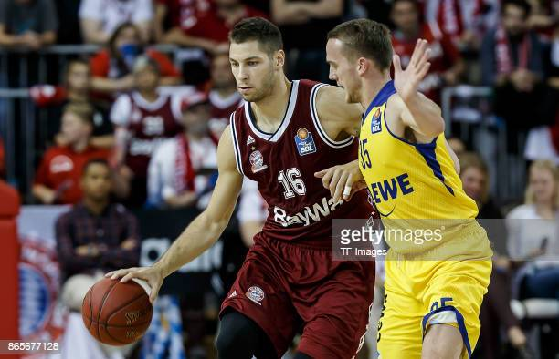 Stefan Jovic of Bayern Muenchen and Brad Loesing of Oldenburg battle for the ball during the easyCredit BBL Basketball Bundesliga match between FC...