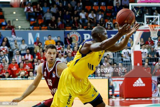 Stefan Jovic of Bayern Muenchen and Rickey Paulding of Oldenburg battle for the ball during the easyCredit BBL Basketball Bundesliga match between FC...