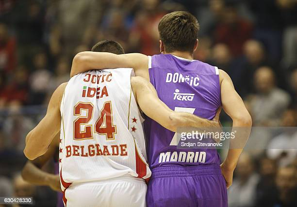 Stefan Jovic of Crvena Zvezda provides assistance to injured Luka Doncic of Real Madrid during the 2016/2017 Turkish Airlines EuroLeague Regular...