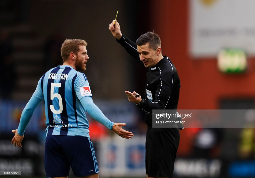 Stefan Karlsson of Djurgardens IF is shown a yellow card by Bojan Pandzic, referee, during the Allsvenskan match between IF Elfsborg and Djurgardens IF at Boras Arena on April 28, 2016 in Boras, Sweden.