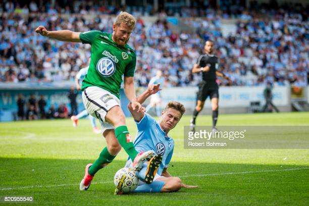 Stefan Karlsson of Jonkopings Sodra and Mattias Svanberg of Malmo FF during the Allsvenskan match between Malmo FF and Jonkopings Sodra IF at...