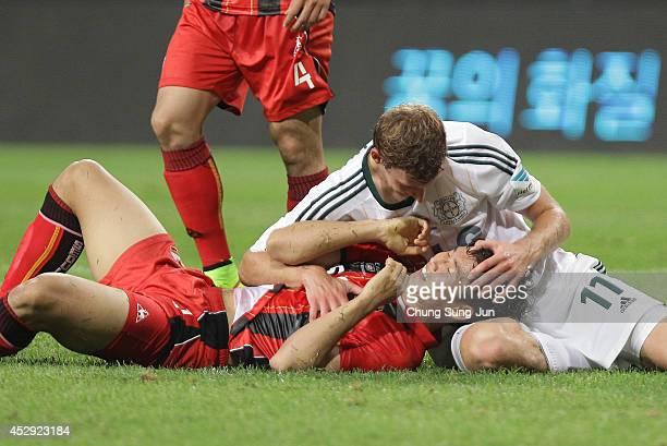 Stefan Kiessing of Bayer Leverkusen and Lee WoongHee react during the match between Bayer Leverkusen and FC Seoul as a part of Bayer Leverkusen's...